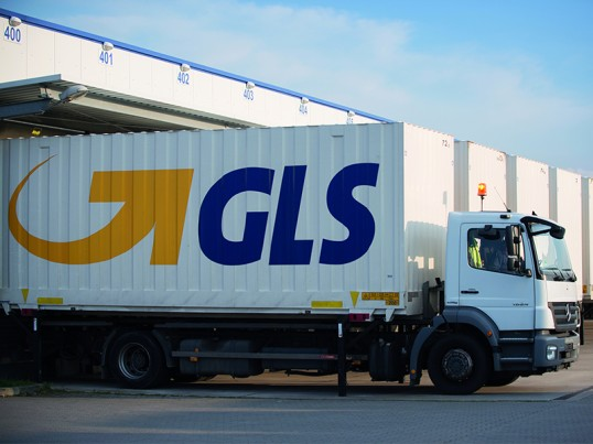 Truck leaving a GLS sorting hub